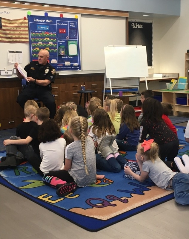 officer myers reading to kindergarten